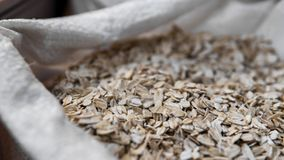 Oat flakes in a bag. Close-up. Texture. Natural organic food. Healthy dietary food rich in microelements cellulose. Food. For vegeterian and people who cares royalty free stock photos