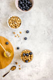 Oat flakes and berries granola glass on table background top view Stock Images