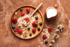 Oat flakes with berries and milk Stock Image