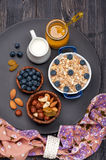 Oat flakes, blueberries, nuts, honey and milk. Fitness breakfast. Royalty Free Stock Photo
