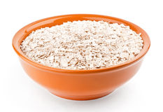 Oat-flakes in bowl Stock Photo