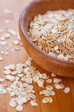 Oat flakes in bowl Royalty Free Stock Photo