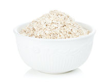 Oat flakes in bowl Stock Photos