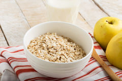 Oat flakes in bowl with apples and milk Stock Photography