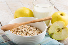 Oat flakes in bowl with apples and milk Royalty Free Stock Photo