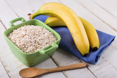 Oat flakes in bowl with banana Stock Photos