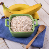 Oat flakes in bowl with banana Royalty Free Stock Image
