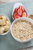 Oat flakes in bowl with banana and strawberry Stock Photos