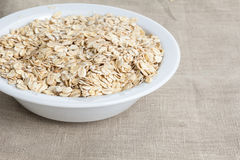 Oat flakes in bowl Stock Photography