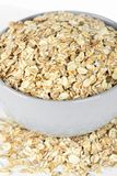 Oat flakes in bowl closeup stock photo