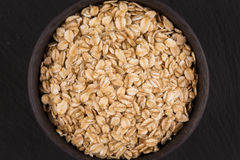 Oat flakes in a bowl Stock Photo