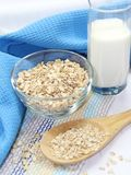 Oat flakes in bowl and milk Royalty Free Stock Photography