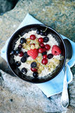 Oat flakes in a bowl, top view. Oat flakes in a bowl with fresh berries Stock Images