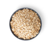 Oat flakes in bowl on white Royalty Free Stock Photography