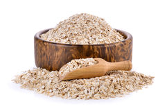Oat flakes in bowl and wood scoop. On white background Royalty Free Stock Photos