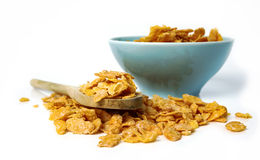 Oat flakes in bowl and wooden spoon on white Stock Photography