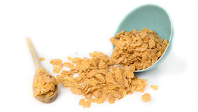Oat flakes in bowl and wooden spoon on white Stock Image