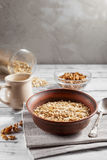 Oat flakes in brown clay bowl ready to cook Stock Image