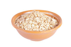 The oat flakes in a ceramic plate Royalty Free Stock Images