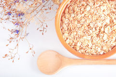 The oat flakes on a ceramic plate Stock Photo