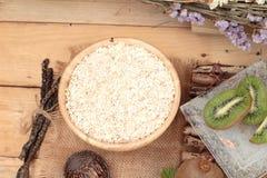 Oat flakes with citrus fruit, kiwi fruit and kiwi juice. Stock Images