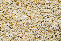 Oat flakes close up background. Oat flakes close up white background Royalty Free Stock Image