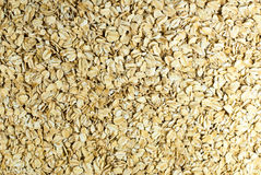 Oat flakes in a direct light. Oat flakes under the directed light royalty free stock image