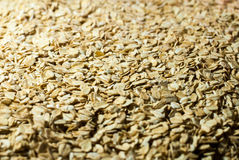 Oat flakes in a direct light. Oat flakes under the directed light stock photography