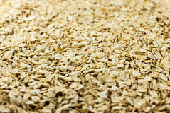 Oat flakes in a direct light. Oat flakes under the directed light stock image