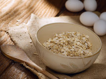 Oat flakes and eggs Royalty Free Stock Photos