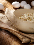 Oat flakes and eggs Stock Photography