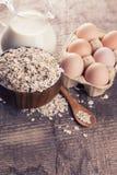 Oat flakes, eggs, milk Stock Image