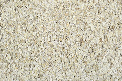 Oat flakes evenly layer background. Horizontal Royalty Free Stock Photos
