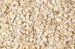 Oat flakes forming a background pattern Royalty Free Stock Images