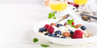 Oat flakes with fresh berries Stock Photos