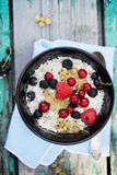 Oat flakes with fresh berries, top view Stock Photography