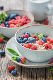 Oat flakes with fresh blueberries and raspberries. On old wooden table Royalty Free Stock Photo