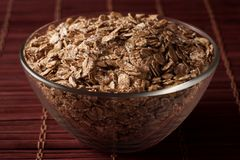 Oat flakes in a glass bowl royalty free stock photo