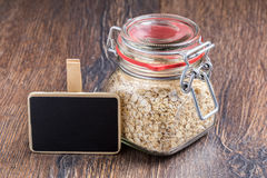 Oat flakes in a glass jar and blackboard Stock Image