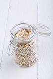The oat flakes in glass jar. Stock Images