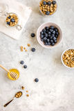 Oat flakes with honey and berries on table background top view Stock Photo