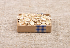 Oat flakes on linen Stock Images
