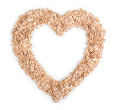 Oat flakes lying in a heart-shaped Royalty Free Stock Photo