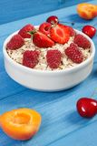 Oat flakes and oatmeal with fruits, healthy lifestyle and nutrition. Fresh prepared oat flakes and oatmeal with fruits, concept of diet, healthy lifestyles and Royalty Free Stock Image