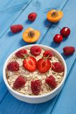 Oat flakes and oatmeal with fruits, healthy lifestyle and nutrition. Fresh prepared oat flakes and oatmeal with fruits, concept of diet, healthy lifestyles and Stock Photography