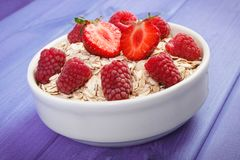Oat flakes and oatmeal with fruits, healthy lifestyle and nutrition. Fresh prepared oat flakes and oatmeal with fruits, concept of diet, healthy lifestyles and Royalty Free Stock Photography
