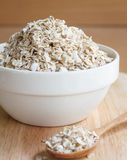 Oat flakes pile in cup. Oat flakes pile in a white cup Stock Image