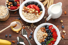 Oat flakes in plate with berries Royalty Free Stock Photo