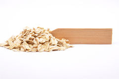 Oat flakes at plate Stock Photography
