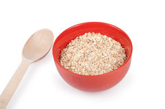Oat flakes in plate  on white Stock Photos